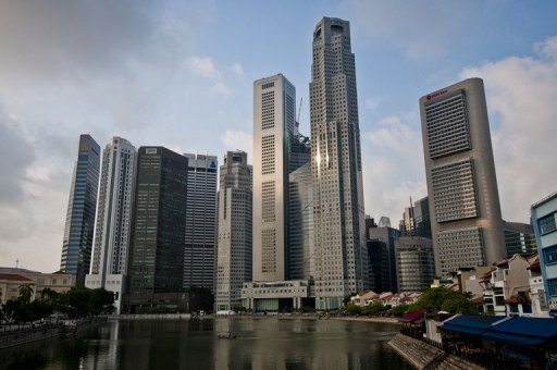 <p>The skyline of Singapore's financial district. One of Singapore's sovereign wealth funds confirmed Monday that it will boost its stake in a Chinese insurer after announcing a shift in focus from developed markets to emerging economies.</p>