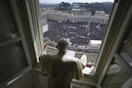 Pope Benedict XVI leads his last Angelus prayer before stepping down in Saint Peter&#39;s Square at the Vatican February 24, 2013. REUTERS/Osservatore Romano