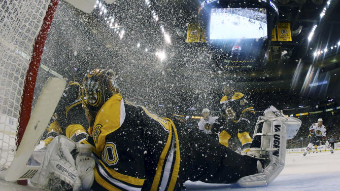 Boston Bruins goalie Tuukka Rask (40), of Finland, defends the net as ice crystals swirl around him during the second period in Game 3 of the NHL hockey Stanley Cup Finals against the Chicago Blackhawks in Boston, Monday, June 17, 2013. (AP Photo/Bruce Bennett, Pool)