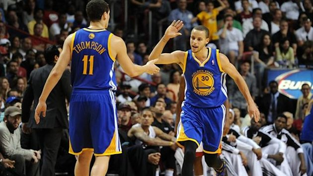Golden State Warriors point guard Stephen Curry (right) greets team-mate Klay Thompson (Reuters)