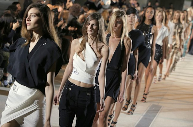 Models wear a creation as part of fashion designer Anthony Vaccarello&#39;s spring-summer 2013 ready to wear collection in Paris, Tuesday, Sept. 25, 2012. (AP Photo/Francois Mori)