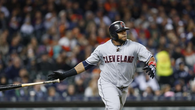 Cleveland Indians' Carlos Santana hits a two-run double against the Detroit Tigers in the fifth inning of a baseball game in Detroit, Friday, April 24, 2015. (AP Photo/Paul Sancya)