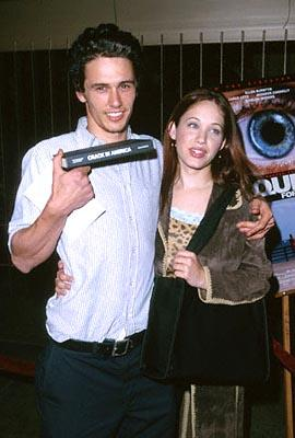 "James Franco holds up his copy of ""Crack In America"" while Marla Sokoloff assures people that James only PLAYED a freak on ""Freaks and Geeks"" at the Egyptian Theatre premiere of Artisan's Requiem For A Dream"