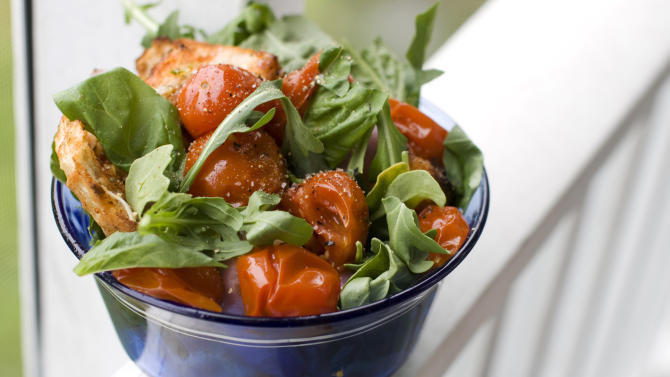 In this image taken on June 10, 2013, a grilled bread and tomato salad is shown served in a bowl in Concord, N.H. (AP Photo/Matthew Mead)
