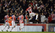 Stoke City's Peter Crouch, center, celebrates scoring against Manchester United during their English Premier League soccer match at the Britannia Stadium, Stoke, England, Saturday Sept. 24, 2011. (AP Photo/Jon Super)
