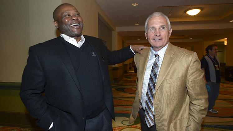 Seattle Mariners manager Lloyd McClendon, left, and New York Mets manager Terry Collins share a laugh at baseball's winter meetings in Lake Buena Vista, Fla., Wednesday, Dec. 11, 2013.(AP Photo/Phelan M. Ebenhack)