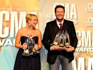 "Miranda Lambert and Blake Shelton pose with their awards at the 46th annual CMA Awards at the Bridgestone Arena on November 1, in Nashville, Tennessee. Shelton took the coveted entertainer of the year honor after collecting laurels for best male vocalist and, with wife Lambert, best song for ""Over You."""