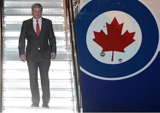Prime Minister Stephen Harper arrives in Bali, Indonesia, on Sunday, October 6, 2013 to attend the APEC Leaders' Meeting. THE CANADIAN PRESS/Sean Kilpatrick
