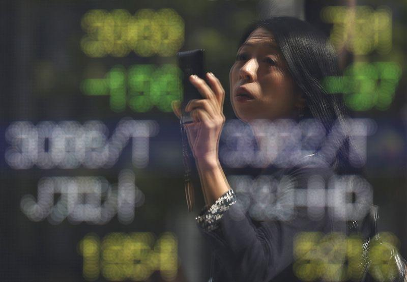 Asian shares slip from two-month high after oil plunges