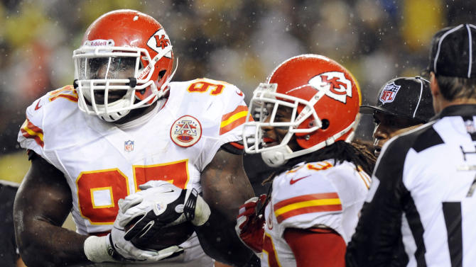 Kansas City Chiefs defensive end Allen Bailey (97) holds the ball after recovering a fumble in the first quarter of an NFL football game against the Pittsburgh Steelers, Monday, Nov. 12, 2012, in Pittsburgh. (AP Photo/Don Wright)