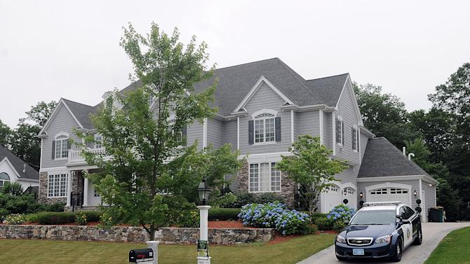 A police car is parked in the driveway outside the home of former New England Patriots football player Aaron Hernandez Thursday, June 27, 2013, in North Attleboro, Mass. A judge on Thursday denied bail for the former NFL player, who is charged with first-degree murder in the shooting death of a friend. (AP Photo/The Attleboro Sun Chronicle, Mark Stockwell) MAGS OUT. MANDATORY CREDIT, PROVIDENCE JOURNAL OUT