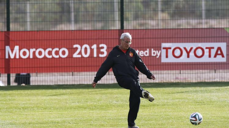 Marcello Lippi, coach of China's Guangzhou Evergrande, kicks a ball during a training session in Agadir Stadium, Agadir