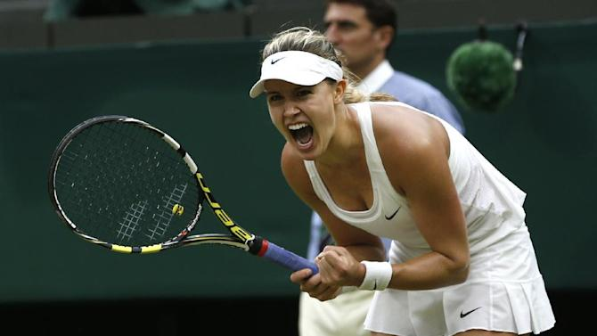 Eugenie Bouchard of Canada celebrates defeating Alize Cornet of France in their women's singles  match at the All England Lawn Tennis Championships in Wimbledon, London, Monday, June 30, 2014