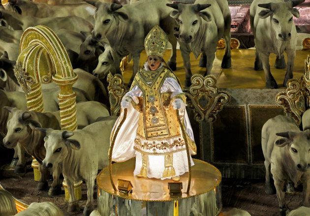 A performer parades atop a float of Unidos da Tijuca samba school during carnival celebrations at the Sambadrome in Rio de Janeiro, Brazil, Tuesday, Feb. 21, 2012. Nearly 100,000 paying spectators turn out for the all-night spectacle at the Sambadrome. (AP Photo/Victor R. Caivano)