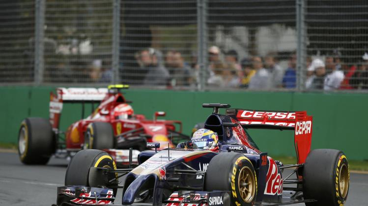 Toro Rosso Formula One driver Vergne of France drives ahead of Ferrari Formula One driver Raikkonen of Finland during the Australian F1 Grand Prix in Melbourne