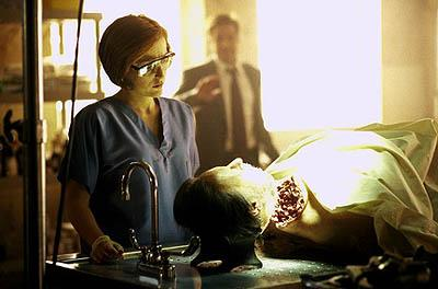 "Agents Scully (Gillian Anderson, L) and Mulder (David Duchovny, R) investigate the bizarre death of a magician in ""The Amazing Maleeni"" episode of Fox's The X-Files X-Files"