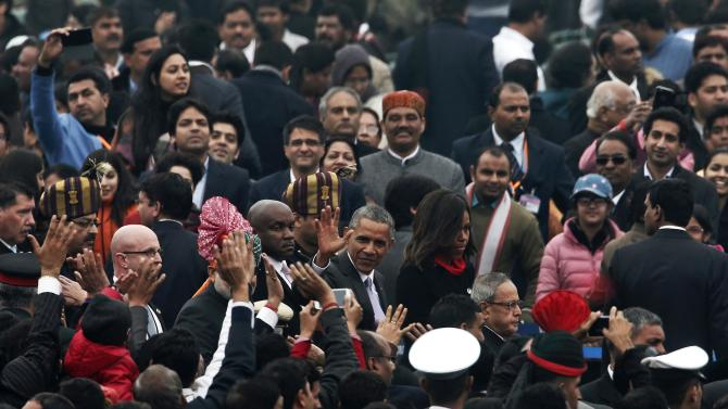 U.S. President Obama flanked by the first lady Michelle, waves after attending the Republic Day parade in New Delhi