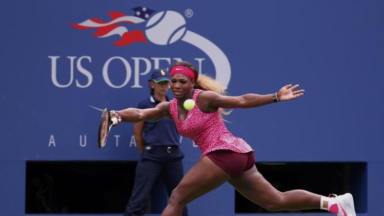 Serena Williams of the U.S. hits a return to compatriot Varvara Lepchenko during their match at the 2014 U.S. Open tennis tournament in New York