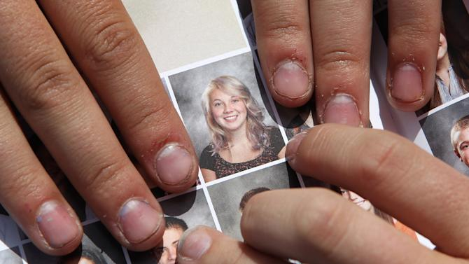 School apologizes to some teens for editing photos