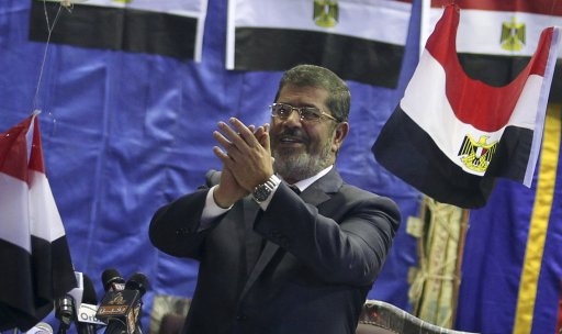 Mohamed Mursi, the Brotherhood's presidential candidate, welcomes his supporters during a campaigning conference in old Cairo