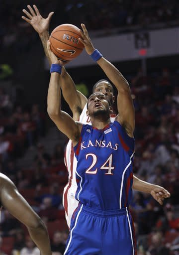 No. 14 Kansas surges to beat Oklahoma 72-61
