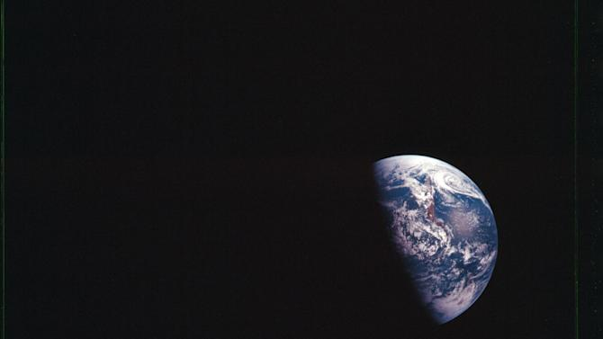 """FILE - In this Dec. 1968 file photo provided by NASA, shows Earth as seen during the Apollo 8 mission. NASA, the agency that epitomized the """"Right Stuff,"""" looks lost in space and doesn't have a clear sense of where it is going, an independent panel of science and engineering experts said in a stinging report Wednesday. (AP Photo/NASA, File)"""