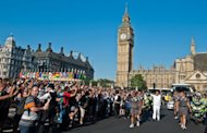 &lt;p&gt;Anthony Page runs with the Olympic Torch through Parliament Square during the London 2012 Olympic Torch Relay, on July 26. Costing 9.3 billion ($14.5 billion) and featuring more than 10,000 athletes, the four-yearly sporting extravaganza will open officially after a rollercoaster build-up.&lt;/p&gt;