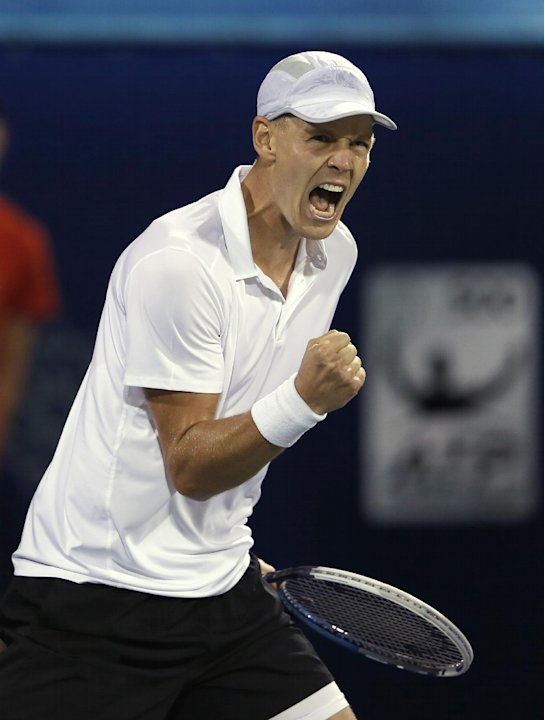 Tomas Berdych of Czech Republic celebrates winning the second set tie-break against Roger Federer of Switzerland during the semi-finals of the Dubai Duty Free Tennis Championships in Dubai, United Ara