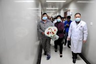 An H7N9 bird flu patient surnamed Li is discharged from the hospital in Bozhou, Anhui province on April 19, 2013. The death toll from the H7N9 bird flu virus has risen to 27, state media said after a man died in central China's Hunan Province