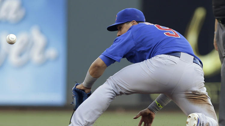 Chicago Cubs second baseman Javier Baez can't catch a base hit by Cincinnati Reds' Billy Hamilton in the first inning of a baseball game, Wednesday, Aug. 27, 2014, in Cincinnati. (AP Photo/Al Behrman)