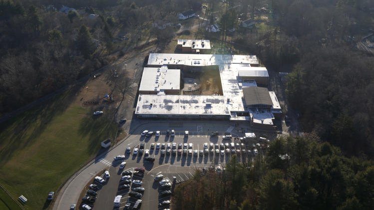 This aerial photo shows Sandy Hook Elementary School in Newtown, Conn. where authorities say a gunman opened fire in a shooting that left 27 people dead, including 20 children, Friday, Dec. 14, 2012. (AP Photo/Julio Cortez)