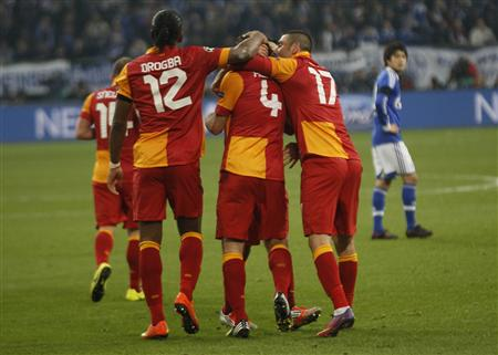 Galatasaray's Drogba and Yilmaz celebrate a goal of Altintop during their Champions League soccer match against Schalke 04 in Gelsenkirchen