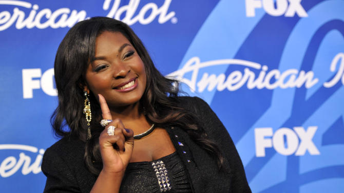 """Winner Candice Glover poses backstage at the """"American Idol"""" finale at the Nokia Theatre at L.A. Live on Thursday, May 16, 2013, in Los Angeles. (Photo by Chris Pizzello/Invision/AP)"""