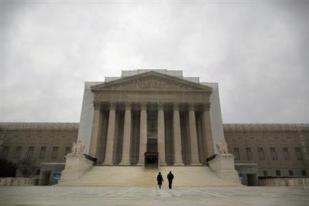 People walk in front of the Supreme Court building in Washington, March 24, 2013. REUTERS/Jonathan Ernst