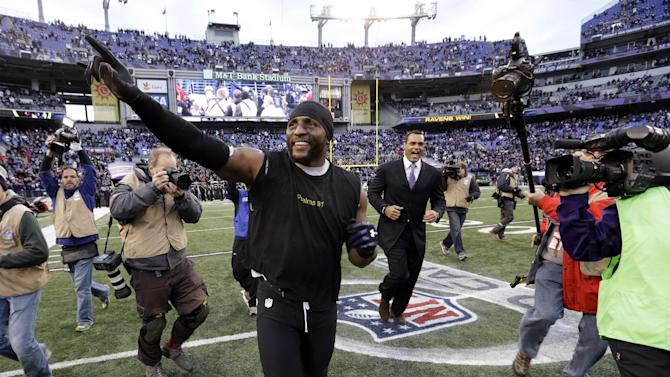 Baltimore Ravens inside linebacker Ray Lewis, center, celebrates with a victory lap around the field after an NFL wild card playoff football game Sunday, Jan. 6, 2013, in Baltimore. Lewis has said he will retire at the end of the season, and the Ravens won 24-9. (AP Photo/Patrick Semansky)