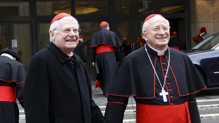 "Cardinal Angelo Scola, left, holds hands with Cardinal Ennio Antonelli as they arrive for an afternoon meeting, at the Vatican, Friday, March 8, 2013. The Vatican says the conclave to elect a new pope will likely start in the first few days of next week. The Rev. Federico Lombardi told reporters that cardinals will vote Friday afternoon on the start date of the conclave but said it was ""likely"" they would choose Monday, Tuesday or Wednesday. The cardinals have been attending pre-conclave meetings to discuss the problems of the church and decide who among them is best suited to fix them as pope. (AP Photo/Alessandra Tarantino)"