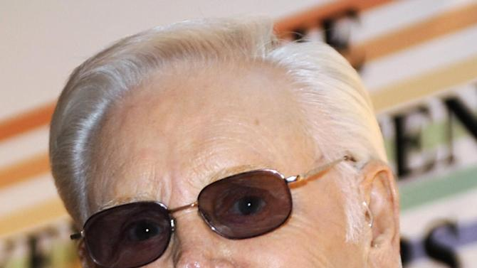 FILE - In this Dec. 7, 2008 file photo, George Jones arrives for the Kennedy Center Honors at the Kennedy Center in Washington. Jones is postponing his upcoming shows on April 20 and 21 in Minnesota and South Dakota so he can have more time to recover from a recent upper respiratory infection. (AP Photo/Jacquelyn Martin, File)