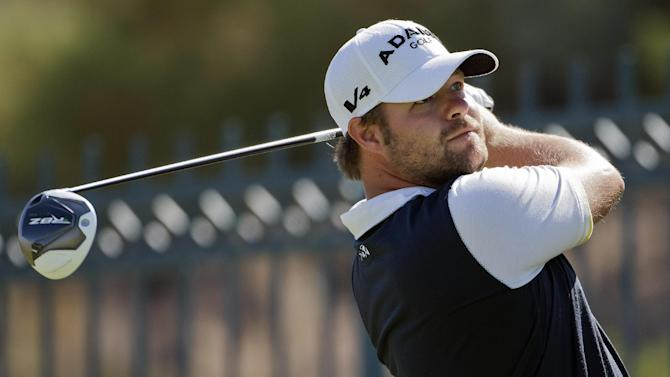 Ryan Moore tees off the sixth hole during the final round of the Justin Timberlake Shriners Hospitals for Children Open golf tournament, Sunday, Oct. 7, 2012, in Las Vegas. (AP Photo/Julie Jacobson)