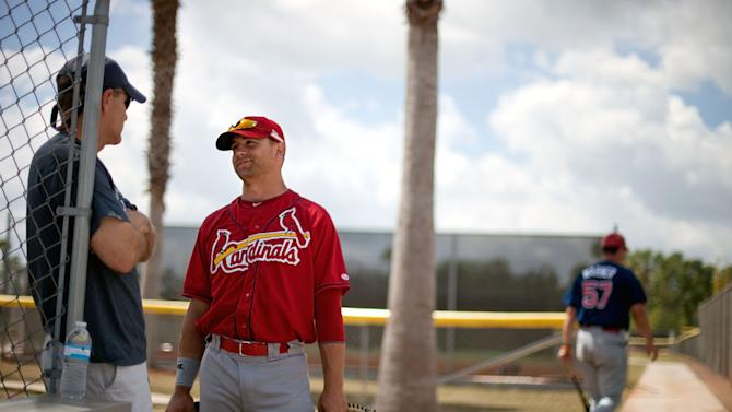 St. Louis Cardinals' Tyler Henley, right, speaks to his dad Van Henley the day he was demoted to AA before a spring training minor league baseball game against the New York Mets Thursday, March 24, 2011 in Port St. Lucie, Fla. Blair and Tyler Henley have been married for two and a half years yet their wedding presents sit unwrapped in storage.   (AP Photo/David Goldman)