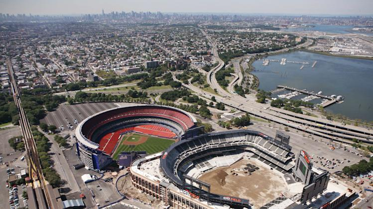 FILE - In this aerial file photo of Sept. 8, 2009, Citi Field, right, is under construction next to the New York Met's Shea Stadium, in New York. A federal prosecutor announced, Tuesday, April 24, 2012, criminal charges and a $40.5 million settlement related to an investigation of Lend Lease U.S. Construction involved in New York City projects including the stadium and the Sept. 11 Memorial. (AP Photo/Mark Lennihan, File)