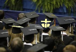 A student wears a mortorboard with a symbol for an aborted fetus, during commencement address by U.S. President Barack Obama at the University of Notre Dame in South Bend