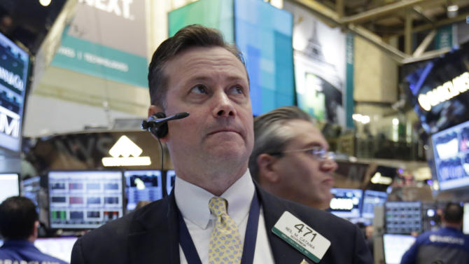 Trader Neil Catania works on the floor of the New York Stock Exchange Monday, March 25, 2013.  U.S. stock markets opened higher after Cyprus clinched a last-minute bailout that saved it from bankruptcy. (AP Photo/Richard Drew)