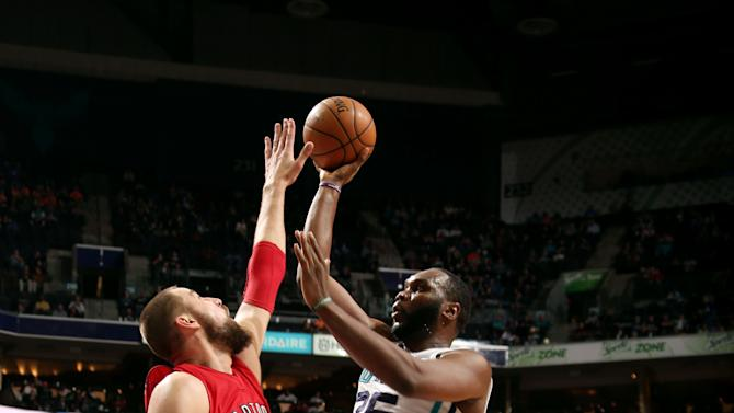 Williams, Hornets top Raptors 103-94 in tech-filled game