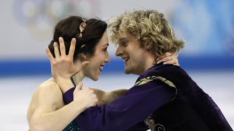 Meryl Davis and Charlie White of the United States compete in the team free ice dance figure skating competition at the Iceberg Skating Palace during the 2014 Winter Olympics, Sunday, Feb. 9, 2014, in Sochi, Russia