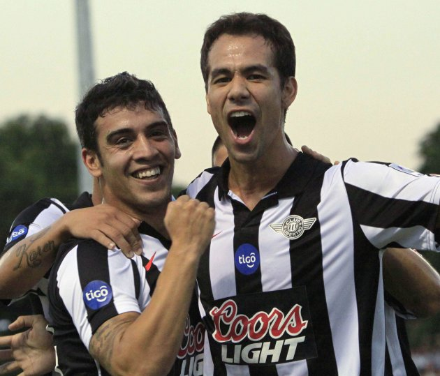 Velazquez and teammate Nunez of Paraguay's Libertad celebrates their team's goal against Brazil's Palmeiras during their Libertadores Cup soccer match in Asuncion