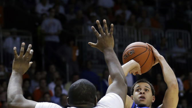 Duke's Seth Curry (30) prepares to shoot over Miami's Reggie Johnson (42) during the first half of an NCAA college basketball game in Coral Gables, Fla., Wednesday, Jan. 23, 2013.   (AP Photo/Alan Diaz)