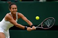 Britain's Heather Watson, pictured in June 2012, won a place in the main draw of the Olympic women's singles on Tuesday after Ukraine's Alona Bondarenko withdrew due to a right knee injury