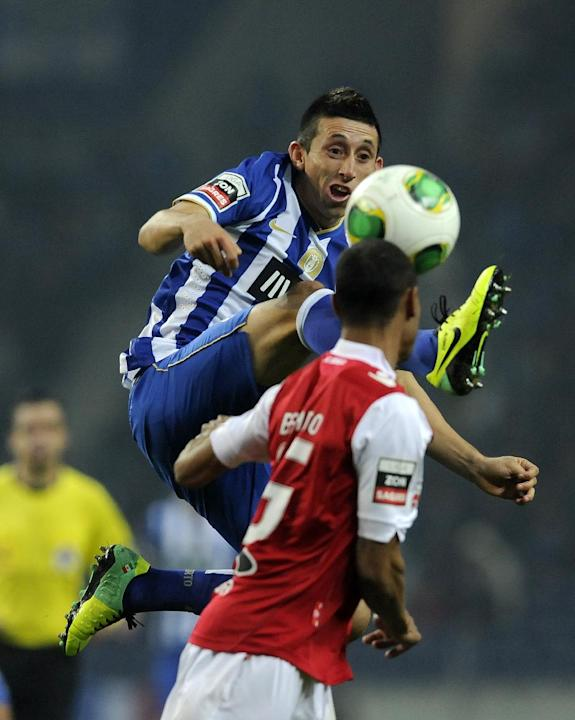 FC Porto's Hector Herrera, from Mexico, rear, vies for a high ball Sporting Braga's Wanderson Baiano, from Brazil, in a Portuguese League soccer match at the Dragao Stadium in Porto, Portugal,