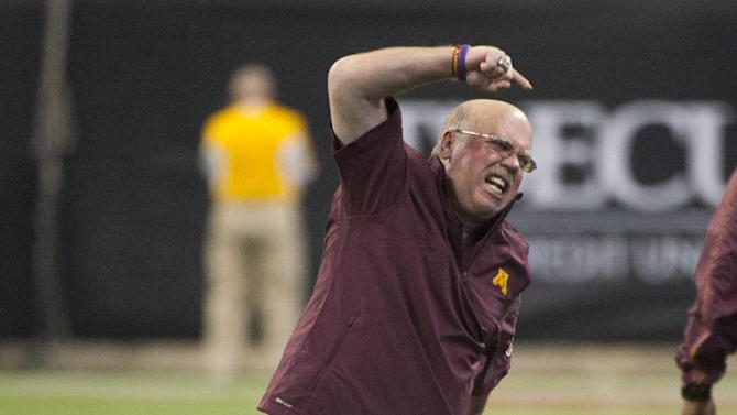 Minnesota coach Jerry Kill reacts to a double penalty during the second quarter against Texas Tech in the Meineke Car Care Bowl NCAA college football game, Friday, Dec. 28, 2012, in Houston. (AP Photo/Dave Einsel)