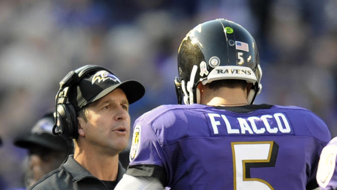 Baltimore Ravens head coach John Harbaugh, left, speaks with Ravens quarterback Joe Flacco after Flacco scored a touchdown in the first half of an NFL football game against the Oakland Raiders in Baltimore, Sunday, Nov. 11, 2012. (AP Photo/Nick Wass)